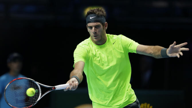 Juan Martin Del Potro of Argentina plays a return to Janko Tipsarevic of Serbia during their singles tennis match at the ATP World Tour Finals in London Thursday, Nov. 8, 2012. (AP Photo/Alastair Grant)