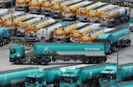 Petronas fuel tanker trucks park at the Klang Valley Distribution Terminal (KVDT) in Dengkil outside Kuala Lumpur. A top Canadian official said his country is not satisfied with the $5.3 billion bid by Malaysian state energy firm Petronas to buy the Canadian gas producer Progress Energy Resources
