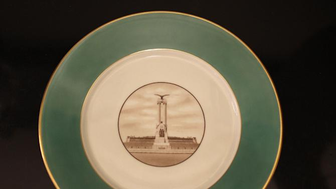 In this Monday, Feb. 4, 2013 photo, a porcelain plate with a picture of the USS Maine monument located in Havana's Malecon, is exhibited on a table at the US Interests Section chief's official residence in Havana, Cuba. The monument was erected in 1925 in honor of U.S. sailors who died in 1898 when the USS Maine ship sank off the Havana Harbor. The years since have been unkind to the twin-columned monument, and to U.S.-Cuba ties. But while relations between Washington and Havana remain in deep freeze, the monument, at least, is now getting a facelift.  (AP Photo/Franklin Reyes)