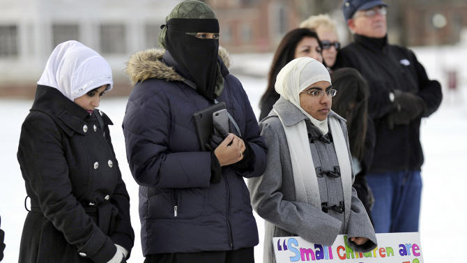 From left, Naveera Karim, Ayesha Akhtar and Anwar Abdulrehman, members of the Islamic Society of Western Connecticut, attend an interfaith prayer vigil to remember the victims of the Sandy Hook elementary school shootings Friday, Dec. 28, 2012 in Newtown, Conn.   Friday morning marked two weeks since a gunman killed 20 children and six educators at the Sandy Hook Elementary School.  (AP Photo/Danbury News-Times, Carol Kaliff)
