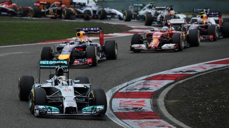 Mercedes AMG Petronas driver Lewis Hamilton (front) takes a turn during the Formula One Chinese Grand Prix, in Shanghai, on April 20, 2014