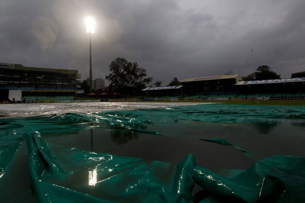 Storm clouds loom over the covered pitch during the first Twenty20 international cricket match between South Africa and Pakistan in Durban