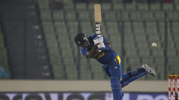 Sri Lanka's Angelo Mathews plays a shot during the Asia Cup one-day international cricket tournament match against Bangladesh in Dhaka, Bangladesh, Thursday, March 6, 2014. (AP Photo/A.M. Ahad)