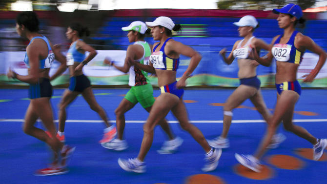 Competitors in the women's 20km race walk stay close together at the start of the race at the Pan American Games in Guadalajara, Mexico, Sunday, Oct. 23, 2011. Guatemala's Jamy Franco, far left, took the gold medal in the event. (AP Photo/Julie Jacobson)