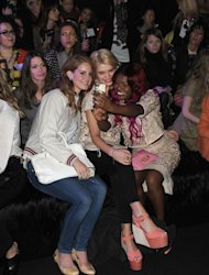 Lana Del Rey (left) with her bespoke bag at the Mulberry show with Pixie Geldof and Azealia Banks (right)
