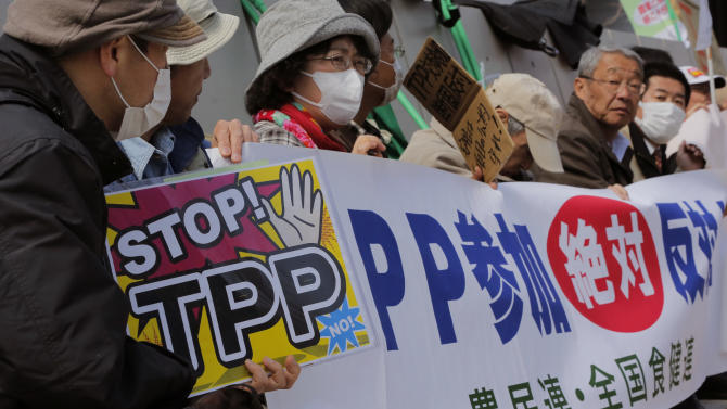 "Farmer protesters rally against the Trans-Pacific Partnership (TPP) in front of the Diet building in Tokyo Friday, March 15, 2013 with a banner reading: ""We absolutely oppose Japan's participation to TPP."" Prime Minister Shinzo Abe is set to announce Japan will join talks on the trade pact that would oblige the country to undertake major reforms, especially in farming. The expected announcement later Friday confirming plans to seek participation in the U.S.-led TPP, is raising protests from farmers opposed to opening protected home markets to foreign competition. (AP Photo/Itsuo Inouye)"