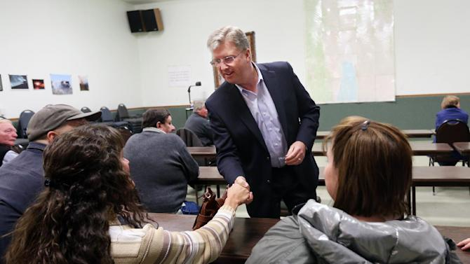 This photo taken Nov. 7, 2013 shows Idaho Republican House candidate Bryan Smith, middle, shaking hands with Laurinda Nussbaum, cq, at a town hall meeting with local residence during a campaign stop for the House seat in Idaho's 2nd Congressional District, in Montpelier, Idaho. Smith is competing in the Republican primary against 8-term Republican incumbent Rep. Mike Simpson. (AP Photo/Kim Raff)