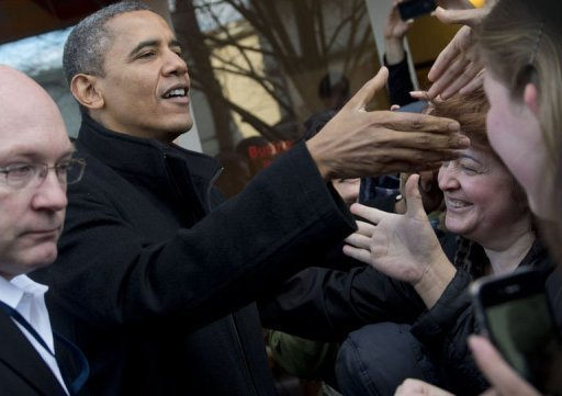 <p>US President Barack Obama greets wellwishers during a shopping trip to One More Page Books on Small Business Saturday, which promotes shopping at local small businesses, in Arlington, Virginia. Congress returns Monday to resume talks with Obama on averting a looming fiscal crisis that could send the entire US economy plunging into recession again.</p>