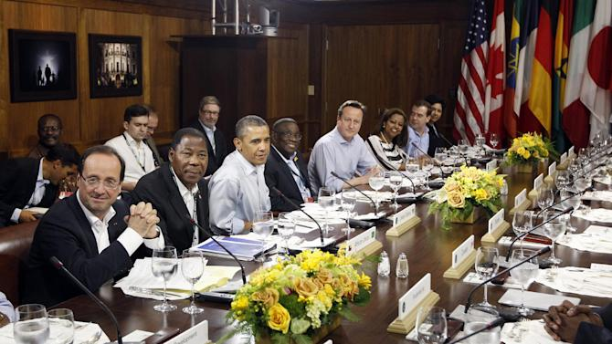 FILE - In this May 19, 2012, file photo, President Barack Obama, third from left, participates in a luncheon at the G-8 Summit at Camp David, Md. A year after Obama made an emphatic pitch to Europe's economic powers to focus more on economic growth than austerity, much of the eurozone remains mired in or near recession. Obama's appeals have had mixed results in softening the demands on some of the most debt-ridden European nations to cut their spending.  From left are, French President Francois Hollande, Benin President Yayi Boni,  Ghanaian President John Atta Mills, British Prime Minister David Cameron, Eleni Gabre Madhin, CEO of the Ethiopia Commodity Exchange, Russian Prime Minister Dmitry Medvedev, Indra Nooyi, CEO of PepsiCo.  ( AP Photo/Charles Dharapak, File)