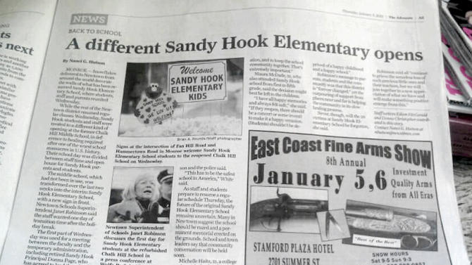 This handout photo shows an ad for a gun show adjacent to an article about the Newtown, Conn. school shooting in the Thursday, Jan. 3, 2013 edition of The Advocate of Stamford, Conn. A statement released Thursday by Hearst Connecticut Media Group's publisher Paul Farrell said the ad's placement was an oversight. (AP Photo)