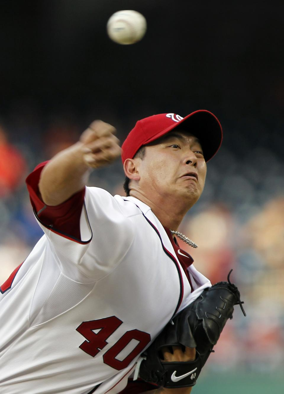 Washington Nationals starting pitcher Chien-Ming Wang throws during the first inning of a baseball game against the Tampa Bay Rays at Nationals Park on Tuesday, June 19, 2012, in Washington. (AP Photo/Alex Brandon)