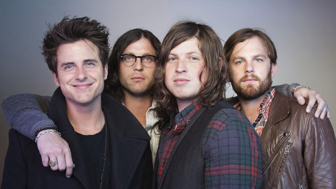 FILE - In this Oct. 21, 2010 file photo, members of the band Kings of Leon, from left, Jared Followill, Nathan Followill, Matthew Followill and Caleb Followill, pose for a portrait in New York. The Kings of Leon promised Sunday, July 31, 2011, to make it up to their Dallas fans after they canceled a show when their lead singer complained it was too hot to perform. In a statement, the band announced plans to return to Dallas on Sept. 21. (AP Photo/Victoria Will, File)