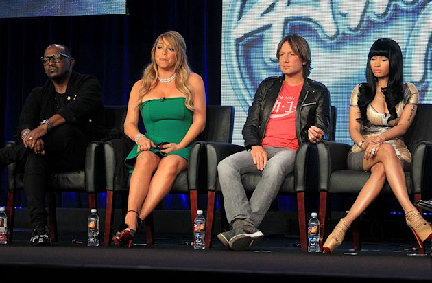 "PASADENA, CA - JANUARY 08:  (L-R) Judges Randy Jackson, Mariah Carey, Keith Urban and Nicki Minaj of ""American Idol"" speak onstage during the FOX portion of the 2013 Winter TCA Tour at Langham Hotel on January 8, 2013 in Pasadena, California.  (Photo by Frederick M. Brown/Getty Images)"