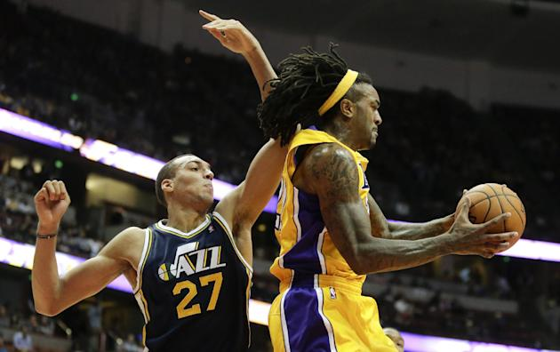 Los Angeles Lakers center Jordan Hill, right, pulls a rebound away from Utah Jazz center Rudy Gobert during the second half of a preseason NBA basketball game in Anaheim, Calif., Friday, Oct. 25, 2013