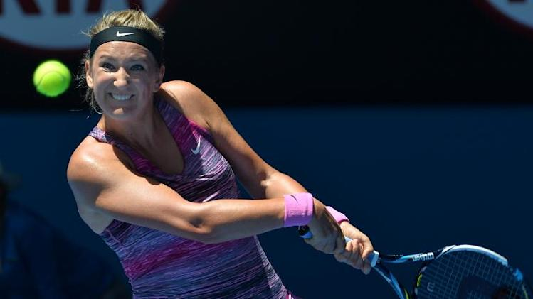 Victoria Azarenka plays a shot during an Australian Open match in Melbourne on January 22, 2014