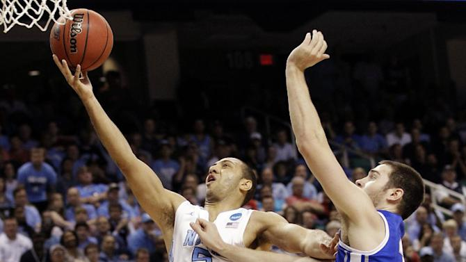 North Carolina's Kendall Marshall, center, drives past Creighton's Josh Jones, rear, and Ethan Wragge, right, during the second half of a third-round NCAA tournament college basketball game in Greensboro, N.C., Sunday, March 18, 2012. North Carolina won 87-73. (AP Photo/Chuck Burton)