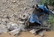 A truck that was destroyed by a landslide lies crushed under rocks after a series of earthquakes hit Yunnan province. Rescuers searching for survivors from twin earthquakes that struck southwestern China battled blocked roads and downed communications as the death toll rose to 80
