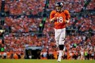 Quarterback Peyton Manning of the Denver Broncos runs onto the field during a game against the Pittsburgh Steelers at Sports Authority Field Field at Mile High on September 9, 2012 in Denver, Colorado. Denver beat the Steelers 31-19