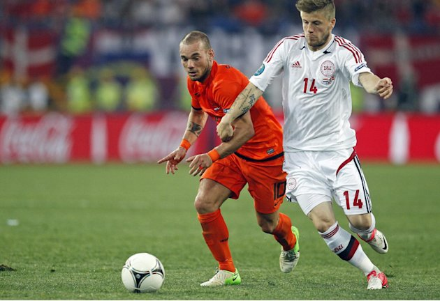 Wesley Sneijder from the Netherlands, left, and Denmark's Lasse Schone fight for possession during the Euro 2012 soccer championship Group B match between the Netherlands and Denmark in Kharkiv , Ukra