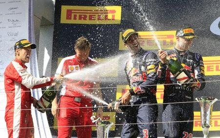 Winner Ferrari Formula One driver Vettel of Germany splashes with champagne on the podium after the Hungarian F1 Grand Prix at the Hungaroring circuit, near Budapest
