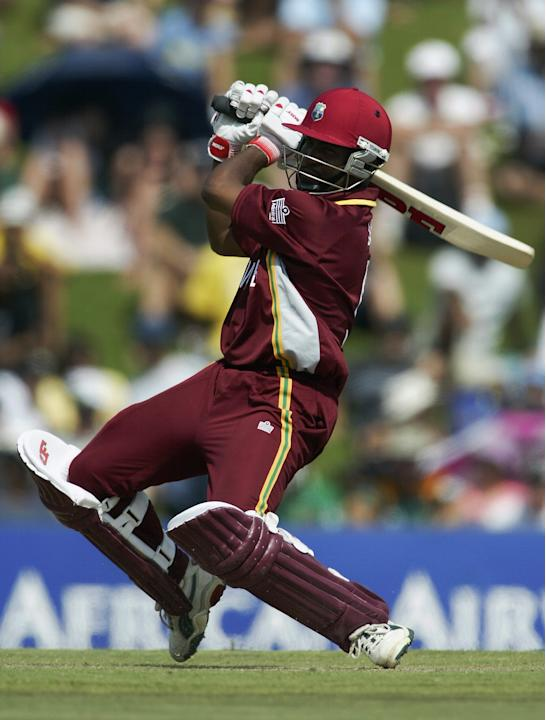 Brian Lara of the West Indies hits a boundary