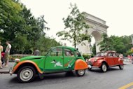 Citroen 2CV cars park by the Washington Square Park arch during the 13th Annual Bastille Day Rally and Rendez Vouz of the Greater New York Citroen & Velosolex Club in New York. New York fans of the Citroen 2CV got a treat Sunday when 20 owners of the iconic French car cruised through Manhattan along with drivers of other Citroen models in honor of France's Bastille Day holiday