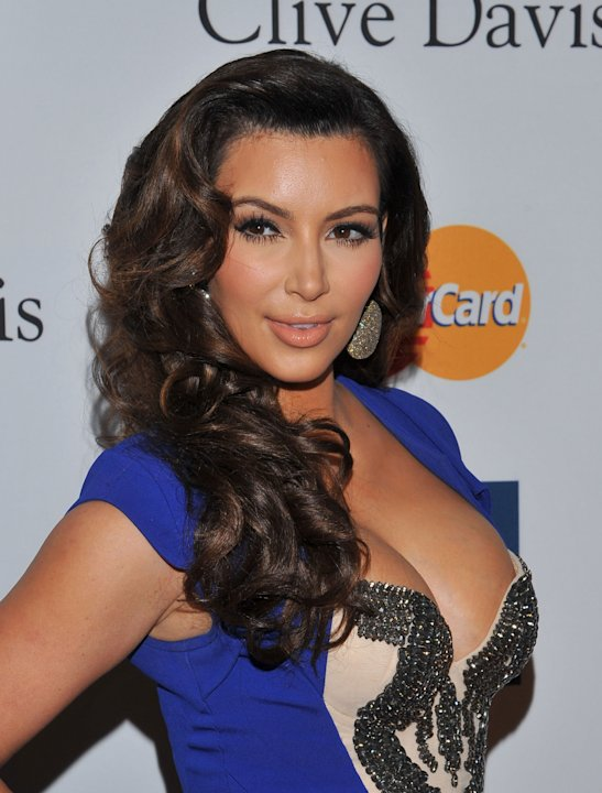 FILE -- In a Feb. 11, 2012 file photo Kim Kardashian arrives at the Pre-GRAMMY Gala &amp; Salute to Industry Icons  in Beverly Hills, Calif.  Sheriff's deputies say a woman threw powder on Kim Kardashian 