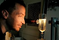 French scientist Gerard Liger-Belair works on a glass of Champagne in his laboratory, on September 13 in Reims, eastern France. Teaching at the University of Reims, Liger-Belair worked with scientists Guillaume Polidori and Philippe Jeandet to find out the exact role of bubbles in the aroma and taste of champagne and engineered glasses to give measurable bubble flow patterns