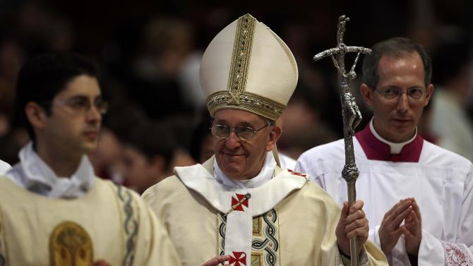 Pope Francis leaves at the end of a mass where he ordained ten new priests in St. Peter's Basilica at the Vatican, Sunday, April 21, 2013. (AP Photo/Gregorio Borgia)