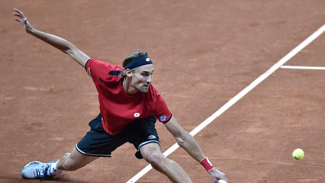 Belgium's Ruben Bemelmans returns the ball to Britain's Andy Murray during their tennis match on the first day of the Davis Cup final between Belgium and Britain at the Flanders Expo in Ghent on November 27, 2015