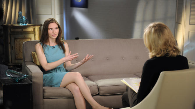 """This April 9, 2013 photo released by ABC shows Amanda Knox, left, speaking during a taped interview with ABC News' Diane Sawyer in New York. Last month, Italy's highest criminal court overturned her acquittal in the 2007 slaying of British student Meredith Kercher and ordered a new trial.  The interview will air on Tuesday, April 30, coinciding with the release of her memoir, """"Waiting to Be Heard.""""  (AP Photo/ABC, Ida Mae Astute)"""