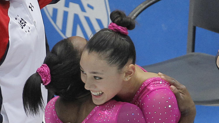 Simone Biles, left, and Kyla Ross, both from the U.S., hug each ...