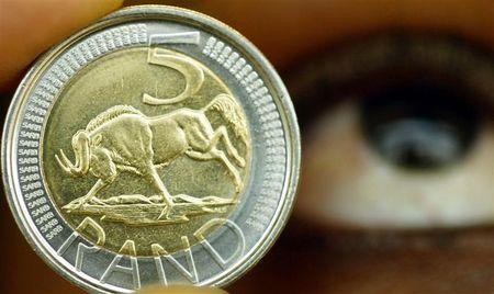 A new five rand coin is displayed during its launch at the South African Mint.