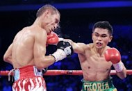 Mexico's Juan Francisco Estrada (L) fights Brian Viloria of the US during their WBO/WBA world flyweight title bout at the 'Fists of Gold' boxing event in Macau on April 6, 2013. Estrada claimed the WBO and WBA flyweight world titles in Macau on Saturday with a split points decision victory over reigning champion Viloria