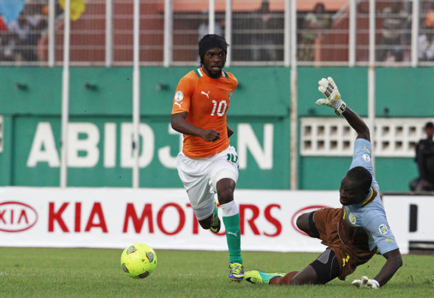 Ivory Coast's Gervinho fights for ball with Senegal's goalkeeper Bouna Coundoul during World Cup qualifying soccer match in Abidjan