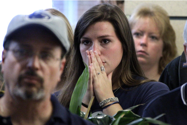 Penn State students, employees, and faculty reacts as they listen to a television in the HUB on the Penn State University main campus in State College, Pa., as the NCAA sanctions against the Penn Stat