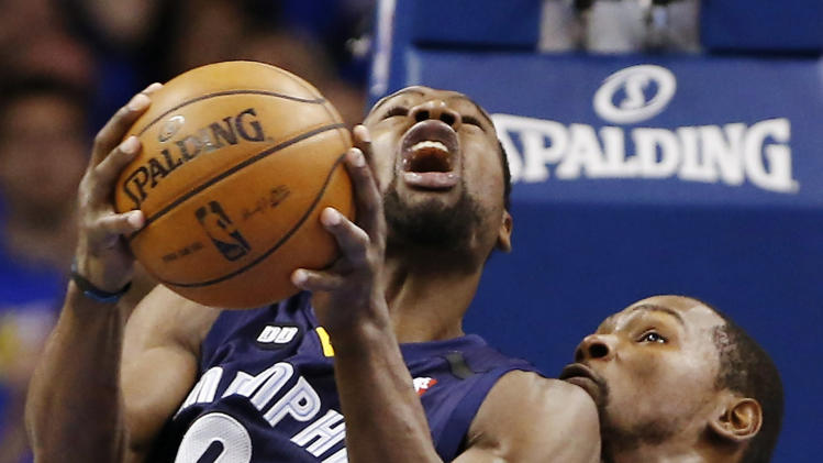 Memphis Grizzlies' Tony Allen, front, eyes the basket as Oklahoma City Thunder's Kevin Durant, rear, defends during the first half of Game 2 of their Western Conference Semifinals NBA basketball playoff series in Oklahoma City, Tuesday, May 7, 2013. (AP Photo/Alonzo Adams)