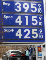 A motorist pumps gas at a Mobile station in Albany, N.Y., on Friday, March 16, 2012. Higher gas prices slow the economy because they force many consumers to cut their spending on other goods, from appliances and furniture to electronics and vacations. (AP Photo/Mike Groll)