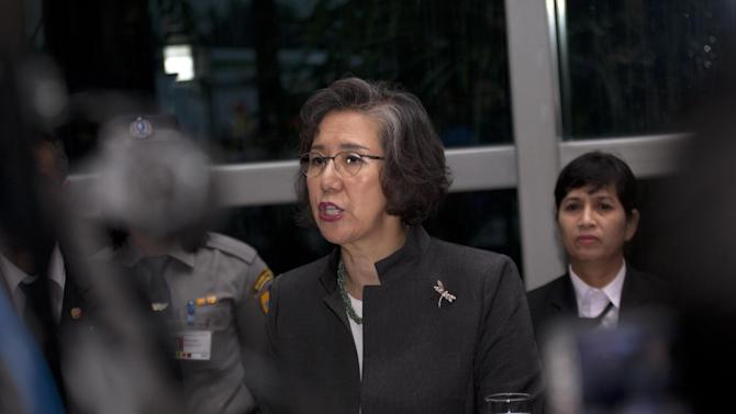 United Nations' Human Rights Special Envoy to Myanmar Yanghee Lee talks to journalists during a press conference at Yangon International Airport in Yangon, Myanmar, before departing for the U.N., Saturday, July 26, 2014. (AP Photo/Khin Maung Win)