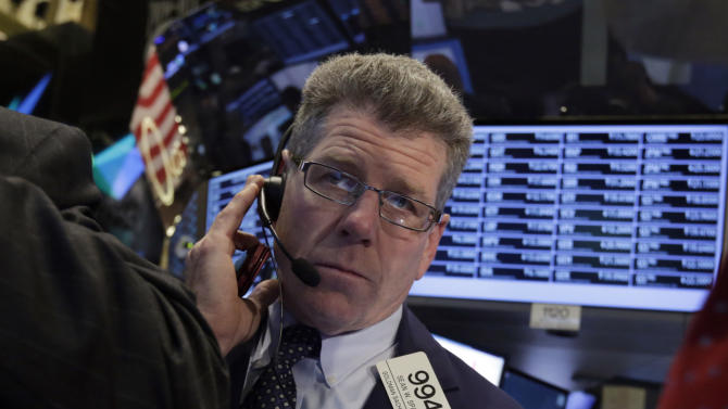 In this Thursday, Oct. 10, 2013 photo, trader Sean Spain works on the floor of the New York Stock Exchange. Three days from a deadline to increase the U.S. debt ceiling, investors were fidgety and stocks drifted lower, Monday, Oct. 14, 2013. The U.S. has to increase the amount of debt it can build up by Oct. 17 or else face a possible default on its debt, a scenario that could derail the U.S. economic recovery and roil international markets. (AP Photo/Richard Drew)