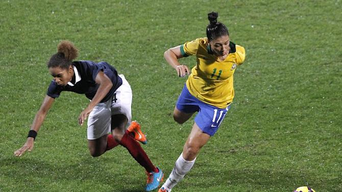 Brazil's Beatriz Zaneratto, right, with France's Laura Georges, left, during their women friendly soccer match in Lyon, central France, Wednesday, Nov. 26, 2014. (AP Photo/Laurent Cipriani)
