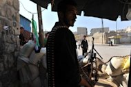 Syrian rebels man a checkpoint in the northern city of Aleppo. Rebels accused strongman Bashar al-Assad on Tuesday of moving chemical weapons to Syria&#39;s borders, a day after his beleaguered regime said it would use its stockpiles if attacked