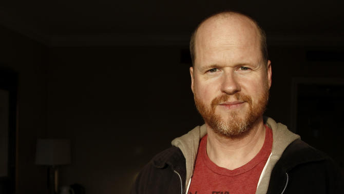"FILE - In this May 4, 2012 file photo, writer and director, Joss Whedon, from the film ""The Avengers,"" poses for a portrait in Beverly Hills, Calif.  Disney Executive Officer, Robert Iger, said on Tuesday, August 7, 2012, during a company earnings call, that Whedon is returning to write and direct the sequel adapted from the Marvel Comics tales. (AP Photo/Matt Sayles, File)"