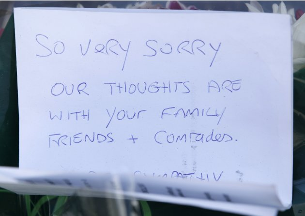 A handwritten note is seen near the scene of the killing of a British soldier in Woolwich, southeast London