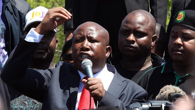 Firebrand politician Julius Malema addresses his supporters after appearing at the Magistrate's Court in Polokwane, South Africa, Wednesday, Sept.  26, 2012, on charges of money laundering in connection with an improper government tender awarded to a company his family trust partly owns. (AP Photo/Themba Hadebe)