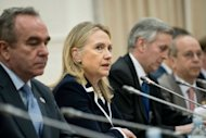 US Secretary of State Hillary Clinton (2nd L) speaks during a bilateral meeting with Chinese Foreign Minister Yang Jiechi. Clinton and her Chinese counterpart pledged Thursday to work more closely together after talks designed to soothe their countries&#39; often spiky relations