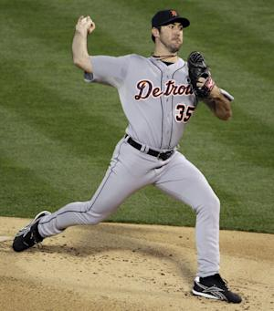 Detroit Tigers starting pitcher Justin Verlander delivers a pitch in the first inning of Game 5 of an American League division baseball series against the Oakland Athletics in Oakland, Calif., Thursday, Oct. 11, 2012. (AP Photo/Eric Risberg)