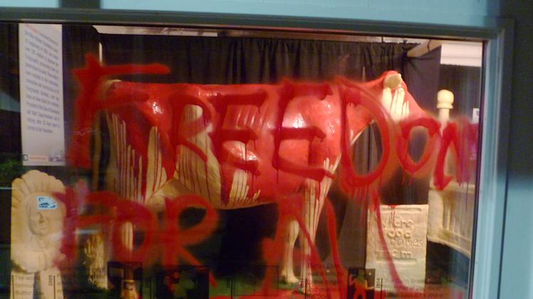 "In this photo provided by Iowans for Animal Liberation is the 2013 butter cow at the Iowa State Fair in Des Moines, Iowa. Authorities confirmed Monday, Aug. 12, 2013, that people had gained access to the display, poured red paint over the butter sculpture and scrawled, ""Freedom for all,"" on a display window. Police said the damage was cleaned up quickly Sunday morning and the display opened as usual. (AP Photo/Iowans for Animal Liberation)"