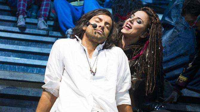 """This undated image released by Boneau/Bryan-Brown shows Ben Forster as Jesus Christ, left, and former Spice Girls member Melanie Chisholm, as Mary Magdalene, in """"Jesus Christ Superstar"""" currently touring in London. """"Jesus Christ Superstar UK Rock Spectacular"""" will be shown at hundreds of movie theaters across America on Oct. 29 and again on Nov. 1. The show was recorded on Oct. 4-5 in Birmingham, England.  (AP Photo/Boneau/Bryan-Brown, Tristram Kenton)"""