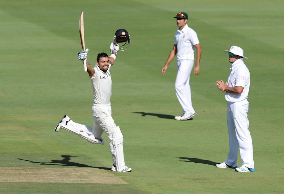 India's batsman Virat Khohli celebrates his century on the first day of the first cricket Test between South-Africa and India at the Wanderers Stadium in Johannesburg on December 18, 2013.           A